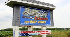 Ground mount monument reflective sign for Team Chesak Exteriors Newburg, Wisconsin