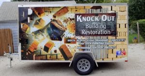 Cargo trailer wrap for Knock Out Building Restoration Fond du Lac, Wisconsin