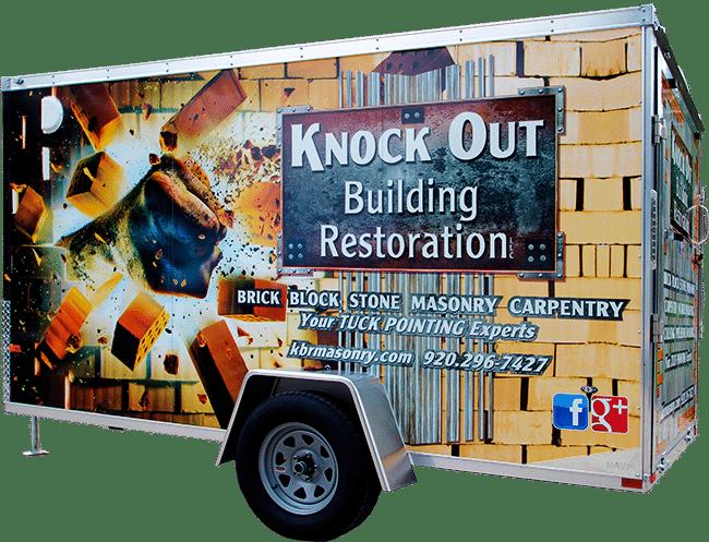 Knock Out Building Restoration vinyl trailer wrap (Fond du Lac, WI).